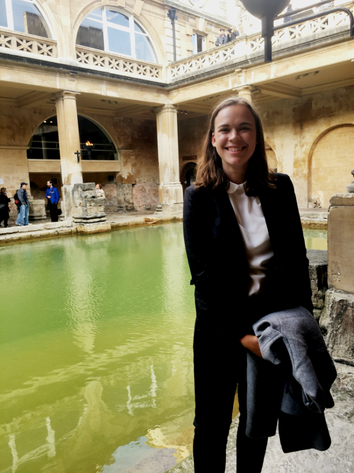 Mayze Teitler posing in front of a fountain during study abroad.