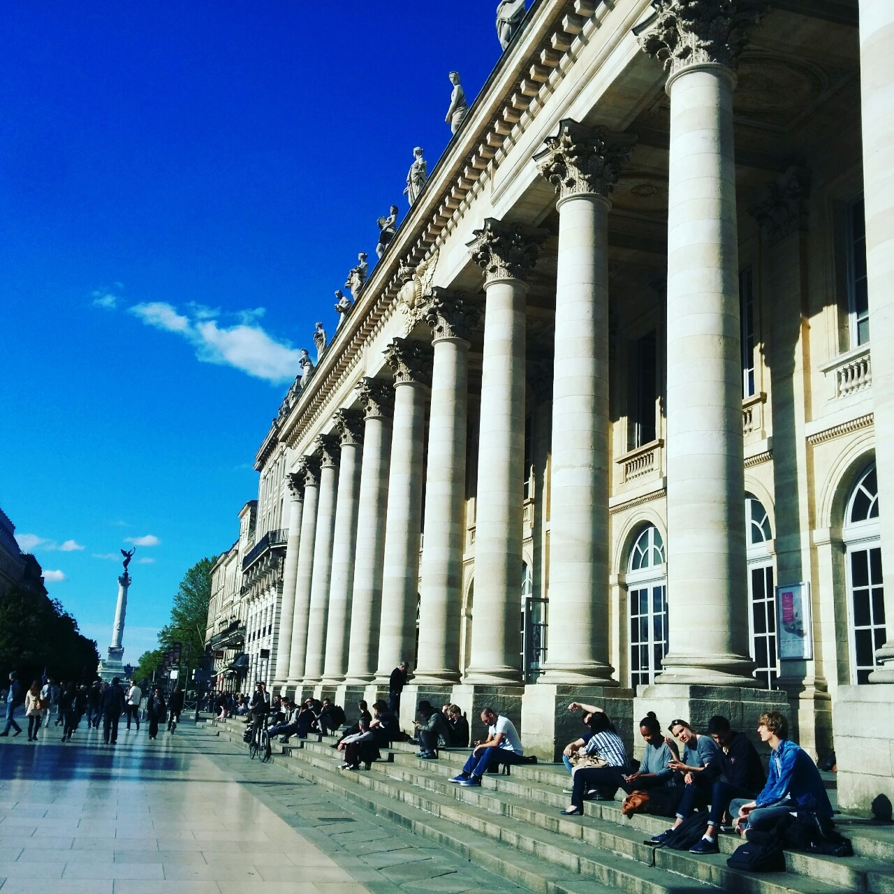 A shot of a building with large white columns in Bordeaux city center