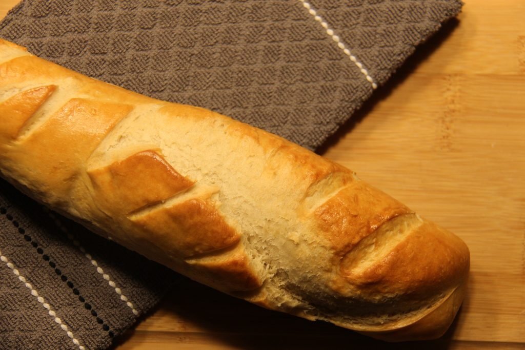 French bread placed on a wooden board.